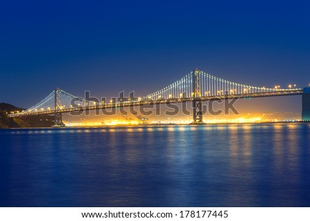 San Francisco Bay Bridge at sunset from Pier 7 in California USA