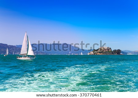 San Francisco bay with prison and yachts - stock photo
