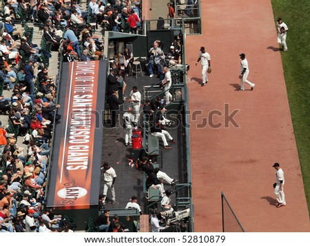 SAN FRANCISCO, CA - APRIL 14: San Francisco Giants players walk off the field and into the dugout in between innings. Taken on April 14, 2010 at At&T Park San Francisco. - stock photo