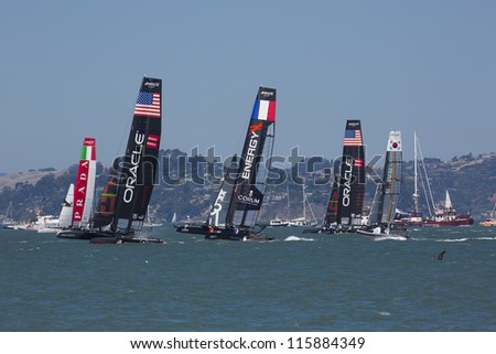 SAN FRANCISCO, CA - AUGUST 26: A few teams tries to overtake the Italian team in the bay of San Francisco during the final of the America's Cup 2012. Aug 26 2012 - stock photo