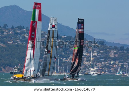 SAN FRANCISCO, CA, AUGUST 26: American team and the Corean team try to overtake the Italian team in the bay of San Francisco during the final of the America's Cup 2012.