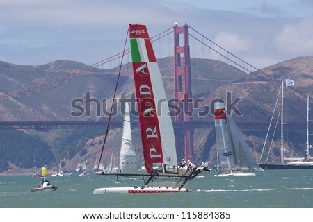 SAN FRANCISCO, CA - AUGUST 26: Chinese team tries to overtake the Italian team in front of the Golden Gate Bridge in the bay of San Francisco during the final of the America's Cup 2012. Aug 26 2012 - stock photo