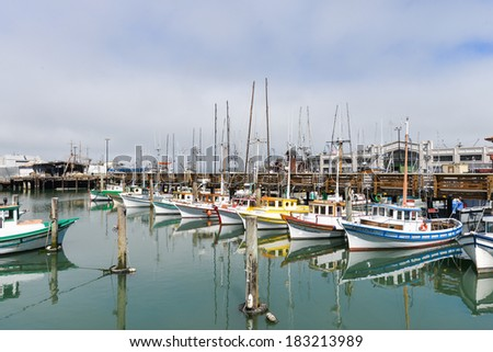 SAN FRANCISCO, CA - AUGUST 16, 2013: Fisher boats at Fisherman's Wharf. Fisherman's Wharf is a prominent tourist attraction point iin downtown San Francisco. - stock photo