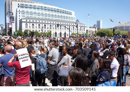 San Francisco, CA - August 25, 2017: Hundreds of people gather in support of the Unite Against Hate rally held at Civic Center in front of City Hall. The Mayor and city leaders speak out against hate.