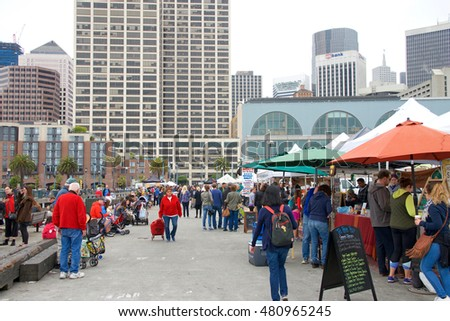 San Francisco, CA - August 20, 2016: Unidentified people at the Ferry Plaza Farmer's Market, renowned throughout the country as one of the top farmers markets having nearly 25,000 shoppers weekly.