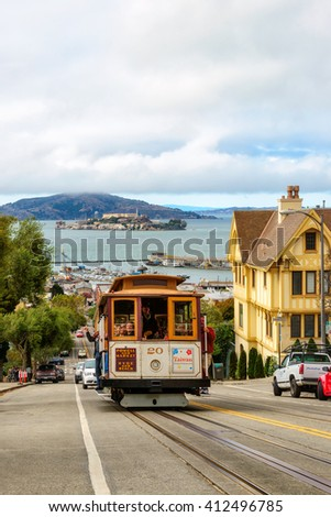 SAN FRANCISCO, CA - CIRCA JULY 2014 - Powell Hyde Cable cars traffic in San Francisco, CA, circa July 2014. Cable car, an iconic tourist attraction - stock photo