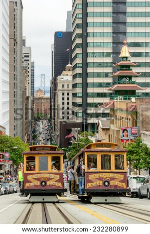 San Francisco, CA - CIRCA JULY 2014 - Two Cable cars traffic in San Francisco, CA, circa July 2014.  - stock photo