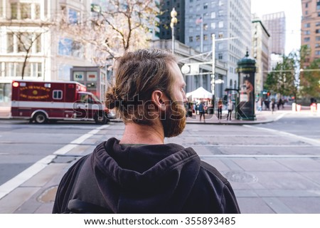 SAN FRANCISCO, CA - DECEMBER 11, 2015: Profile of a man looking to his right in downtown San Francisco. - stock photo