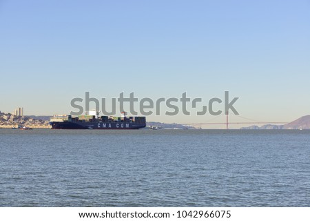 San Francisco, CA - December 31, 2015: The container ship the Benjamin Franklin, 10th largest container ship and the largest to visit the US arriving in San Francisco the morning of December 3