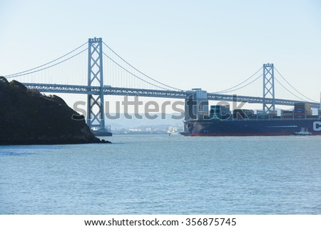 San Francisco, CA - December 31, 2015: The newest container ship the Benjamin Franklin, world 10th largest container ship and the largest to visit the US arriving in San Francisco, December 31, 2015. - stock photo