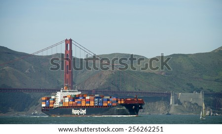 SAN FRANCISCO, CA - FEBRUARY 26, 2015: Hapag-Lloyd Cargo Ship KOBE EXPRESS entering the San Francisco Bay under the Golden Gate Bridge on its way to the Port of Oakland. - stock photo