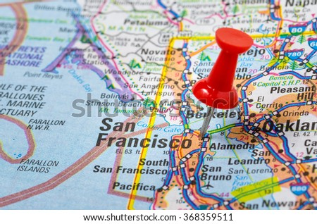 San Francisco, CA, Highlighted on a Road Map by a Red Pushpin. Shallow Deep of Field - stock photo