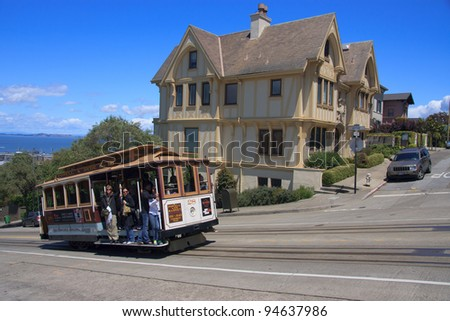 SAN FRANCISCO, CA - JUNE 18: The San Francisco cable car system is the world's last operational manually operated cable car system. An icon of San Francisco, California. June 18, 2011 in San Francisco - stock photo