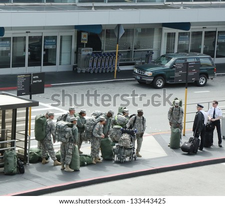 SAN FRANCISCO,CA - MARCH 29: American soldiers returning home from duty in San Fransisco Airport on March 29, 2013. - stock photo