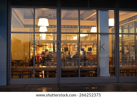 SAN FRANCISCO, CA - MARCH 29, 2015: Local residents gather this morning at their usual table in the Ferry building to have a little breakfast, coffee and conversation. - stock photo