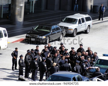 SAN FRANCISCO, CA - MAY 15:Group of Police Officers gather to discuss tactics outside by police cars on May 15, 2011 in San Francisco. - stock photo