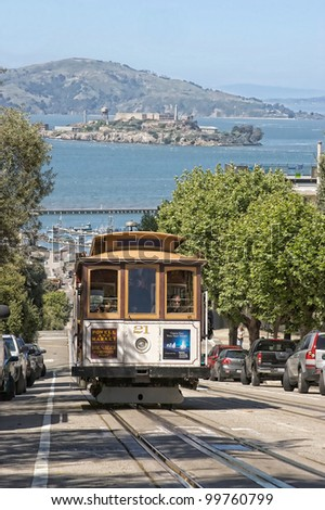 SAN FRANCISCO Ca. - MAY 6: Passengers ride in a cable car on May 6, 2010 in San Francisco. It is the most popular way to get around the City of San Fransisco. - stock photo
