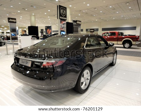 SAN FRANCISCO, CA - NOVEMBER 20:  A black Saab 95 on display at the 53rd International Auto Show on November 20, 2010 in San Francisco, CA. - stock photo