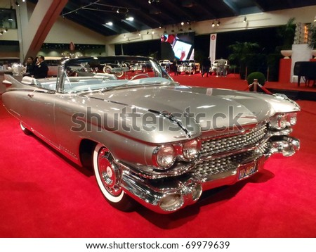 SAN FRANCISCO, CA - NOVEMBER 20: Classic Convertible Cadillac Car Shines on display feature fins on the back at the 53rd International Auto Show, on Saturday November 20, 2010 San Francisco, CA. - stock photo