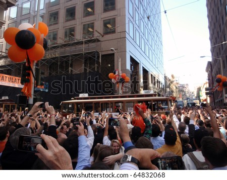 SAN FRANCISCO, CA - NOVEMBER 3: Giants fans celebrate the passing of trolleys during championship parade with fans waving and taking photos Nov. 3, 2010 San Francisco, CA. - stock photo