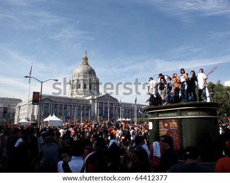 SAN FRANCISCO, CA - NOVEMBER 3: People standing everywhere and on everything hoping to get a look at San Francisco Giants during ceremony for winning world series in the Civic Center on Nov. 3, 2010 San Francisco, CA. - stock photo