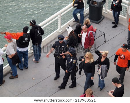 SAN FRANCISCO, CA - OCTOBER 28: Aerial view of crowd of people walk along sidewalk towards 2010 World Series game on Second Street with cars Oct. 28, 2010 AT&T Park San Francisco, CA. - stock photo