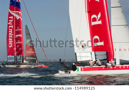 SAN FRANCISCO, CA - OCTOBER 4: Emirates Team New Zealand and Italy's Team Luna Rossa Piranha compete in the America's Cup World Series sailing races in San Francisco, CA on October 4, 2012 - stock photo