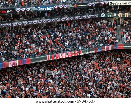 SAN FRANCISCO, CA - OCTOBER 20: Giants crowd told to get 'Louder!' to help cheer on team game 4 of the 2010 NLCS game between Giants and Phillies Oct. 20, 2010 AT&T Park San Francisco, CA. - stock photo