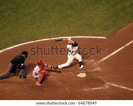 SAN FRANCISCO, CA - OCTOBER 20: Giants vs. Phillies: Freddy Sanchez swings for contact in the batters box with Carlos Ruiz catching game 4 of the NLCS 2010 October 20, 2010 AT&T Park San Francisco.