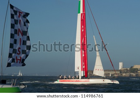 SAN FRANCISCO, CA - OCTOBER 4: Luna Rossa Piranha skippered by Chris Draper crosses the finish line in the America??s Cup World Series sailing races in San Francisco, CA on October 4, 2012 - stock photo
