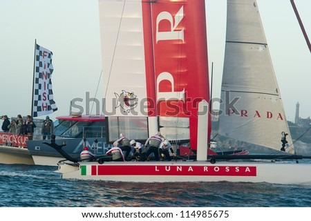 SAN FRANCISCO, CA - OCTOBER 4: Luna Rossa Swordfish crosses the finish line in the America'??s Cup World Series sailing races in San Francisco, CA on October 4, 2012 - stock photo