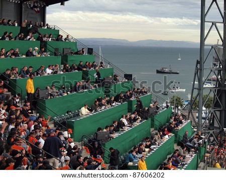 SAN FRANCISCO, CA - OCTOBER 28: Overflow Media watches baseball game in the upperdeck with view of water during game 2 of the 2010 World Series game at AT&T Park on Oct. 28, 2010 in San Francisco, CA. - stock photo