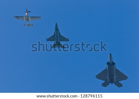 SAN FRANCISCO, CA - OCTOBER 7: P-51 Mustang WW II and modern F-16C Fighting Falcon and USAF F-22 Raptor aircrafts perform heritage flight during Fleet Week in San Francisco, CA on October 7, 2012 - stock photo