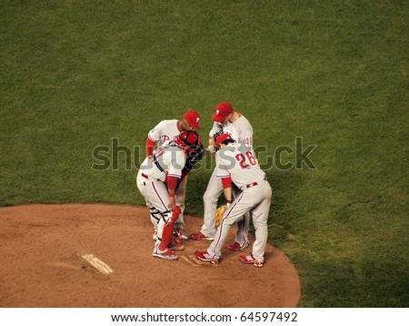 SAN FRANCISCO, CA - OCTOBER 20: Phillies infield talks with pitcher Ryan Madson on the mounds game 4 of the 2010 NLCS game between Giants and Phillies Oct. 20, 2010 AT&T Park San Francisco, CA. - stock photo