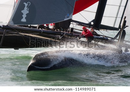 SAN FRANCISCO, CA - OCTOBER 4: Sweden's Artemis Racing Red sailboat skippered by Nathan Outteridge competes in the America'??s Cup World Series sailing races in San Francisco, CA on October 4, 2012 - stock photo