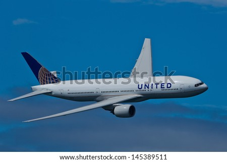 SAN FRANCISCO, CA - OCTOBER 5:  United Airlines Boeing 777 (N212UA) demonstration during Fleet Week in San Francisco, CA on October 5, 2012. - stock photo