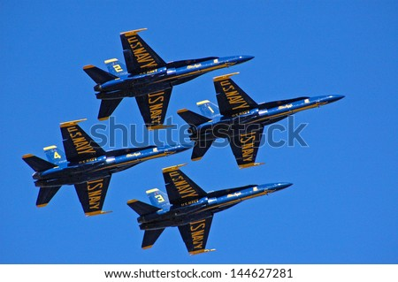 SAN FRANCISCO, CA - OCTOBER 6: US Navy Blue Angels in FA-18 Hornet planes perform at Fleet Week in San Francisco, CA on October 6, 201. Blue Angels flight demonstration squadron was formed in 1946. - stock photo
