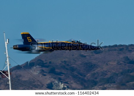 SAN FRANCISCO, CA - OCTOBER 7: US NAVY Blue Angels, on Boeing F/A-18 Hornet showing precision of flying and the highest level of pilot skills during Fleet Week on October 7, 2012 in San Francisco, CA