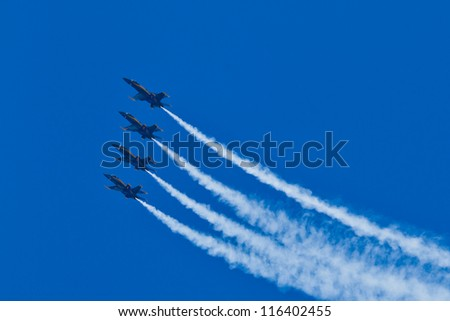 SAN FRANCISCO, CA - OCTOBER 7: US NAVY Blue Angels, on Boeing F/A-18 Hornet showing precision of flying and the highest level of pilot skills during Fleet Week on October 7, 2012 in San Francisco, CA - stock photo