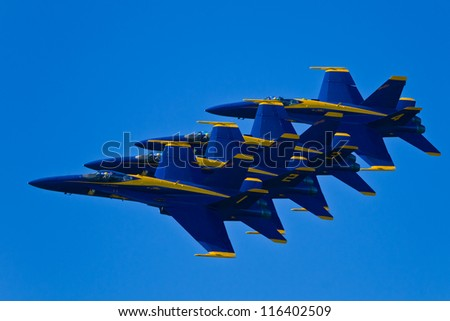 SAN FRANCISCO, CA - OCTOBER 6: US NAVY Blue Angels, on Boeing F/A-18 Hornet showing precision of flying and the highest level of pilot skills during Fleet Week on October 6, 2012 in San Francisco, CA - stock photo