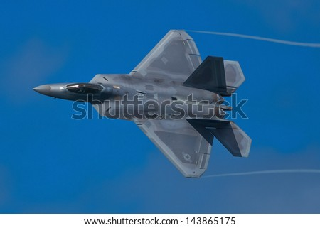 SAN FRANCISCO, CA - OCTOBER 5:  USAF F-22 Raptor aircraft demonstration during Fleet Week in San Francisco, CA on October 5, 2012 - stock photo