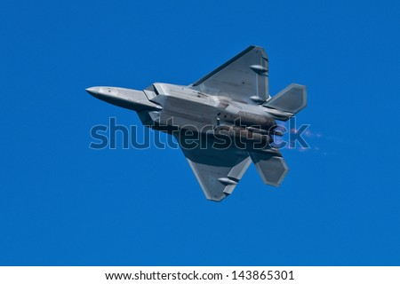 SAN FRANCISCO, CA - OCTOBER 6:  USAF F-22 Raptor aircraft demonstration during Fleet Week in San Francisco, CA on October 6, 2012 - stock photo