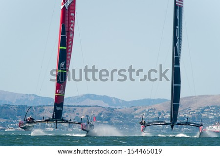 SAN FRANCISCO, CA - SEPTEMBER 12: Emirates Team New Zealand and Oracle Team USA compete in the America's Cup sailing races in San Francisco, CA on September 12, 2013 - stock photo