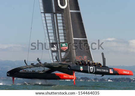 SAN FRANCISCO, CA - SEPTEMBER 12: Oracle Team USA competes in the America's Cup sailing races in San Francisco, CA on September 12, 2013 - stock photo