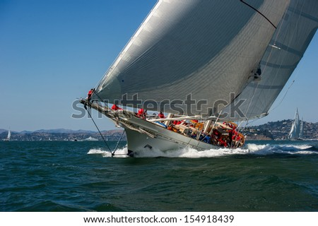 SAN FRANCISCO, CA - SEPTEMBER 13: Super yacht Adela competes in a regatta during the America's Cup in San Francisco, CA on September 13, 2013 - stock photo