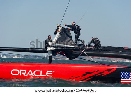 SAN FRANCISCO, CA - SEPTEMBER 12: The crew of Oracle Team USA changes sails in the America's Cup sailing races in San Francisco, CA on September 12, 2013 - stock photo