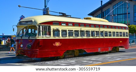 SAN FRANCISCO CA USA APRIL 16 : Historic street car transporting passengers on april 16 2015 in San Fransisco CA USA. San Francisco street cars come from all around the wolrd.