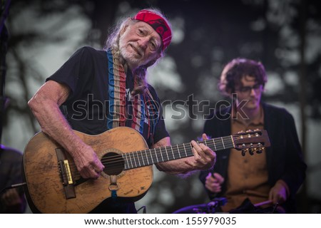San Francisco, CA USA - August 11, 2013: Willie Nelson and son Micah performing at the 2013 Outside Lands music festival Sutro Stage.  - stock photo