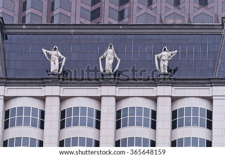 San Francisco, California - January 16, 2016 - Corporate Goddesses statues on top of building at the corner of California and Kearney street in San Francisco, CA. - stock photo