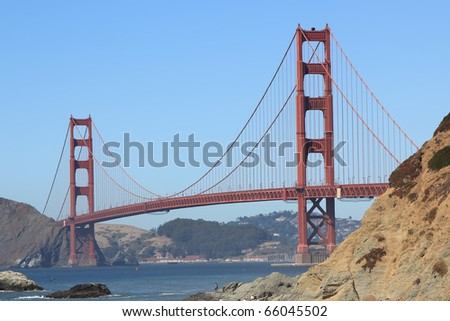 SAN FRANCISCO, CALIFORNIA - SEPTEMBER 1, 2010: Golden Gate Bridge taken from Baker Beach on September 1, 2010. The beach is a well known location near San Francisco's Golden Gate Park. - stock photo